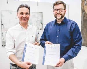 Demant und Weimann mit Zertifikat
